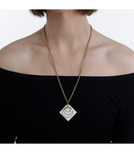 Three brass rings on a white piece necklace