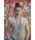 Long silk necklace with a metal piece and a tassel